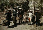 Annam, Hue 1931 - A group of An Nam people stood by Cai Quan Street.jpg