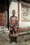 Trung Ky, Hue 1931 - An official dressed in a royal dress with the crown of Canh Chuon, stood ...jpg