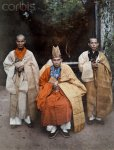1931, Vietnam --- Two bonzes of Hue stand beside an Annamite priest.jpg