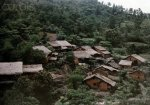 1931, Tonkin, Vietnam --- A view of the thatched mud huts of the Tho people in the wooded hills.jpg